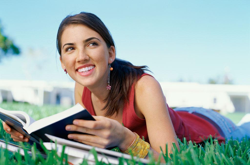 teen_girl_reading_outdoors_57281977