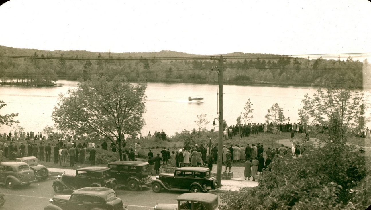 Crowd Watching Airplane Land on Horn Pond