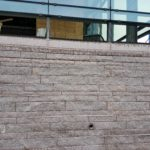 Addition's granite foundation facade completed