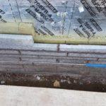 Addition's granite foundation facade in progress