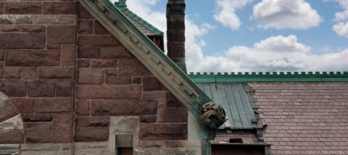 Up close view of the fox carved into the masonry of the Richardson building's North side